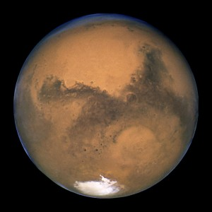 Mars as seen from the Hubble Space Telescope, showing the Hellas Basin at bottom right.